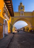 Ciudad de Guatemala, Guatemala, April, 25, 2018: Outdoor view of Santa Catalina arch and the main street of Antigua city. At sunny day in Guatemala Stock Images