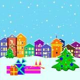 Ciudad de la Navidad con los presentes y los árboles Imagen de archivo
