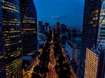 Ciudad de Mexico - Reforma Avenue night scene. Mexico City, Reforma avenue buildings, and Estela de luz monument night scene aerial shot Royalty Free Stock Images