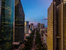Ciudad de Mexico - Reforma Avenue sunset shot. Mexico City, Reforma avenue buildings, and Estela de luz monument sunset scene aerial shot Royalty Free Stock Photography