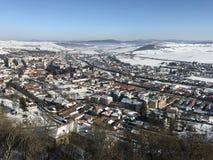 Ciudad de Rupea, cubierta con nieve Foto de archivo libre de regalías
