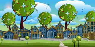 ciudad fabulosa con las pequeñas casas en el fondo de árboles grandes Foto de archivo libre de regalías