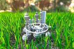 Ciudad futurista en el fondo de la ecología del concepto de la hierba verde Fotos de archivo libres de regalías
