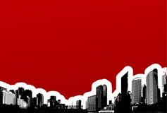 Ciudad negra en fondo rojo. Imagenes de archivo