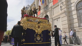 CIUDAD REAL, SPAIN - APRIL 14, 2017: Passing of sculptures of Jesus carrying cross and roman soldier with a spear during day. Procession of Holy Week Semana stock video footage