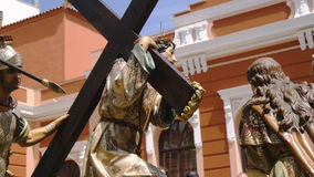 CIUDAD REAL, SPAIN - APRIL 14, 2017: Passing of sculptures of Jesus carrying cross and roman soldier with spear in Prado gardens. During day procession of Holy stock footage