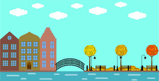 Ciudad vieja europea con el puente en el río y el parque en otoño Fotos de archivo