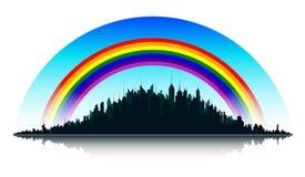 Ciudad y arco iris Foto de archivo
