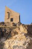 Ciudadela medieval Rupea de la fortaleza en la puesta del sol Foto de archivo