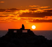 Ciutadella Menorca at Punta Nati sunset with girl Royalty Free Stock Photography