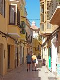 Two older men walking in the street in Ciutadella Menorca town center stock images