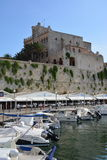 Ciutadella Port. The port of Ciutadella with boats and restaurants looking up to the old fortified walls of the town and the city council Royalty Free Stock Photography
