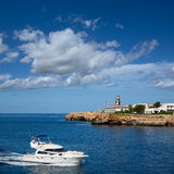 Ciutadella Sa Farola Lighthouse with yatch boat Stock Photography