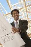 Civiel-ingenieur Holding Blueprint Stock Afbeelding