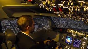 Civil aircraft cockpit. Pilot of passenger aircraft at work. Approaching stock video footage