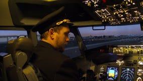 Civil aircraft cockpit. Pilot of passenger aircraft at work before departure stock video