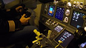 Civil aircraft cockpit. Pilot of passenger aircraft at work. Approaching stock video footage