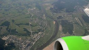 Civil aircraft turns over the city, view from the salon stock video footage