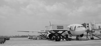 Civil airplan docking at Tan Son Nhat airport in Saigon, Vietnam.  Royalty Free Stock Photography
