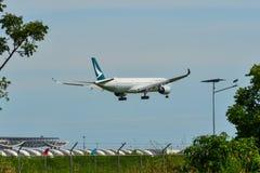 Civil airplane landing at Suvarbhunami Airport royalty free stock images