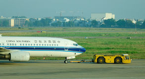 Civil airplane on runway at the Changi airport in Singapore Royalty Free Stock Photo