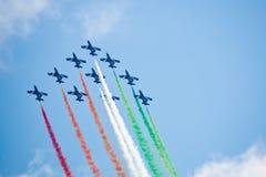 Civil airplanes making aerobatic manoeuvres Royalty Free Stock Photo