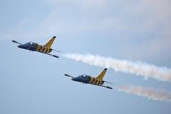 Civil airplanes making aerobatic manoeuvres Royalty Free Stock Image