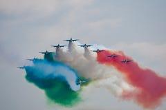 Civil airplanes making aerobatic manoeuvres Stock Photos