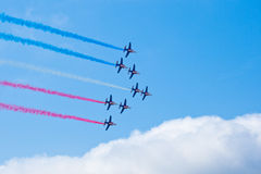 Civil airplanes making aerobatic manoeuvres Royalty Free Stock Images