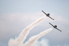Civil airplanes making aerobatic manoeuvres at Int Royalty Free Stock Photography