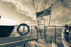 Civil banner United Kingdom flag on sailing boat Stock Images