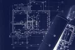 Civil building sketch drawings, rolled blueprints on dark blue s. Urface. architect workplace background. double exposure royalty free stock photography