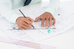 Civil design. Close-up of a worker developing the design of a civil building Stock Image