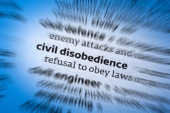 Civil Disobedience. Is the refusal to comply with certain laws or to pay taxes and fines, as a peaceful form of political protest. Mohandas Gandhi was a figure stock photo