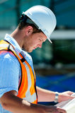 Civil Engineer. Young Handsome Male Civil Engineer, Checking The Blueprints stock image