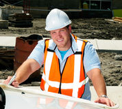 Civil Engineer. Looking At The Plans To A Construction Site On The Hood Of His Car stock photo