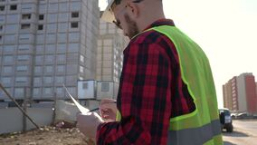 Civil engineer checking work for communication to management team in the construction site