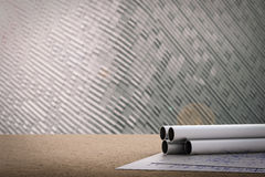 Civil engineer concept. With metal pipes and blueprint paper Stock Image