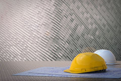 Civil engineer concept. With safety helmets and blueprint paper Royalty Free Stock Images