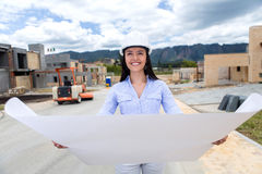 Civil engineer holding blueprints Stock Photo