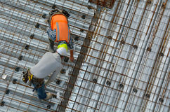 Civil engineer inspecting the work progress of a worker in a con Royalty Free Stock Photography