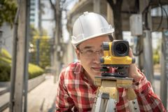 Civil engineer land survey with tacheometer or theodolite equipm stock images