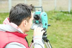 Civil engineer land survey with tacheometer or theodolite equipment. Worker Checking construction site on the road.  royalty free stock photos