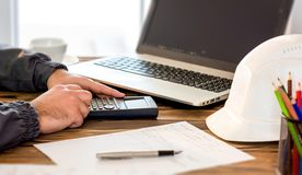 Civil Engineer making Structural Analysis Calculations Royalty Free Stock Image