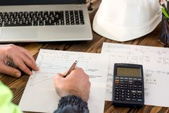 Civil Engineer making Structural Analysis Calculations. Civil Design Engineer is making structural analysis calculations using a scientific calculator Stock Images