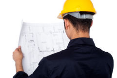 Civil engineer reviewing blueprint Stock Images