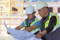 Civil Engineer And Senior Foreman At Construction Site Stock Photography