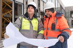 Civil Engineer And Senior Foreman At Construction Site Stock Photo