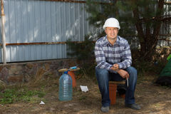 Civil Engineer Sitting at Construction Site Corner Royalty Free Stock Photo