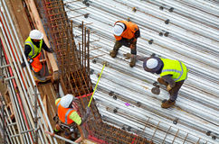 Civil engineer supervise roof construction workers work Stock Image
